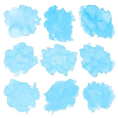 Ensemble d'aquarelle bleue sur fond blanc, aquarelle de pinceau, illustration vectorielle. vecteur