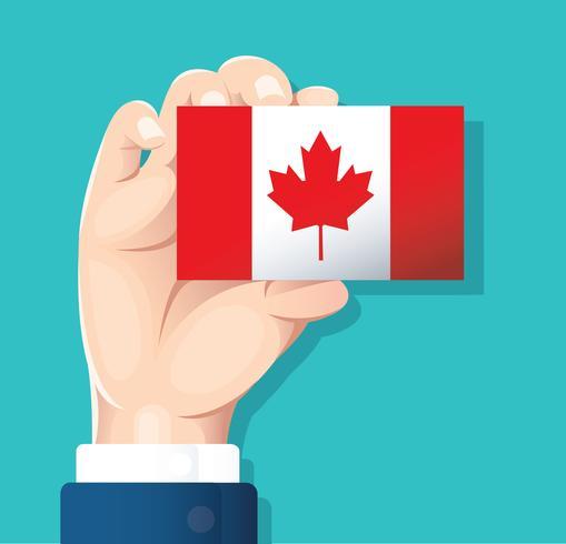 main tenant la carte drapeau Canada avec fond bleu vecteur