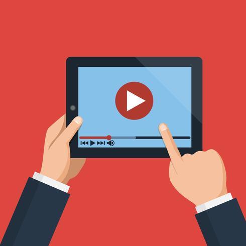 Mains tenant une tablette avec lecteur vidéo à l'écran vecteur