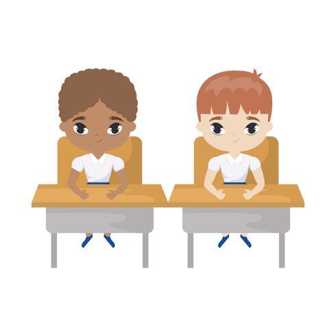 petits élèves assis dans les pupitres d'école vecteur