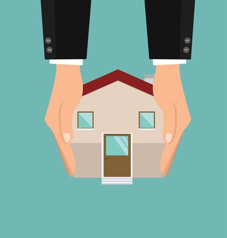 Mains tenant avec vecteur maison