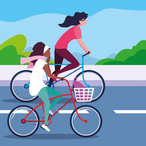 jeunes femmes à vélo sur la route vecteur