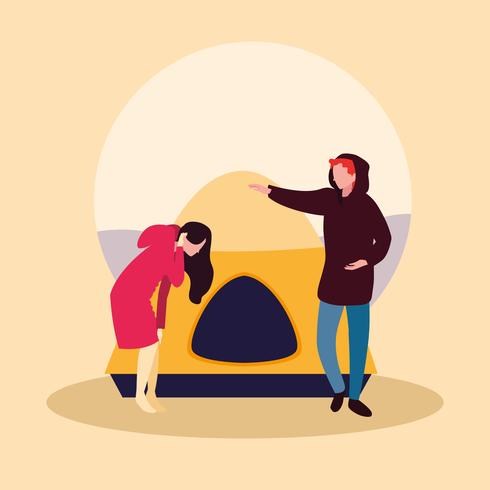 jeune couple en train de camper vecteur