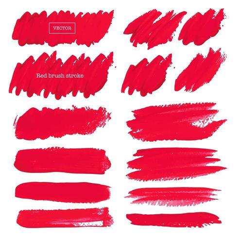 Ensemble de coups de pinceau rouge sur fond blanc vecteur