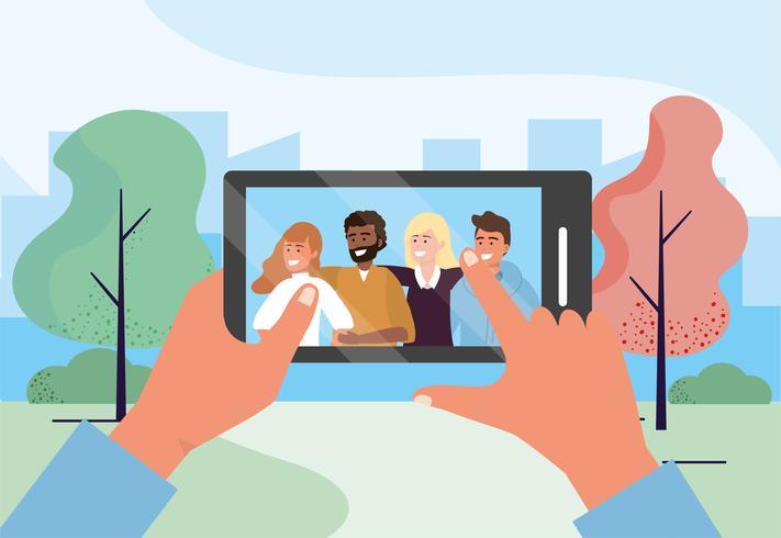 Selfie smartphone d'un groupe d'amis dans un parc vecteur