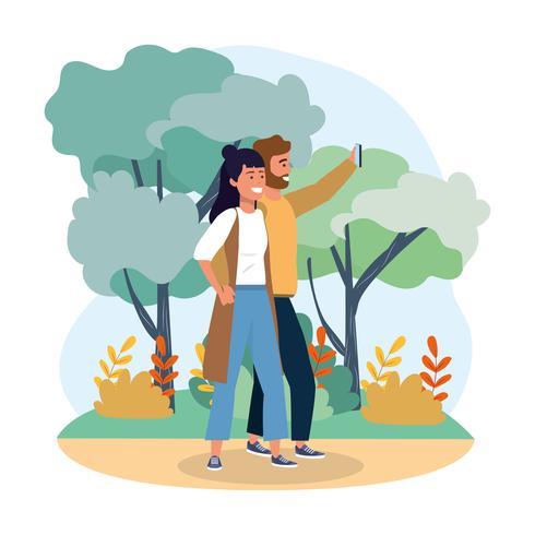 Couple prenant selfie dans le parc vecteur