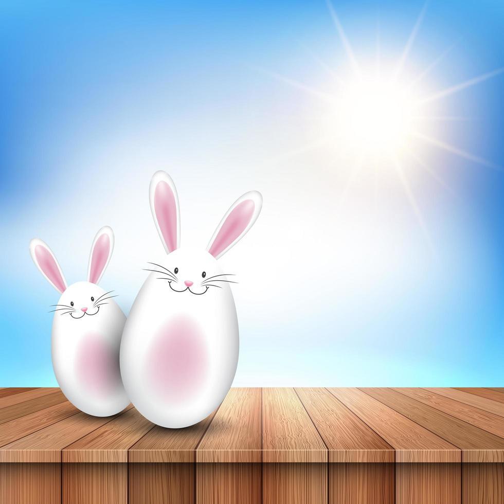 lapins d'oeufs de Pâques sur la surface en bois vecteur