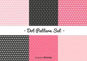 Ensemble de motifs de points roses et noirs vecteur