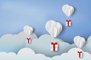 Ballons en papier 3D avec des cadeaux dans les nuages vecteur