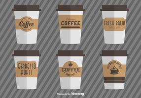 Tasses à café avec manches en carton à café vecteur