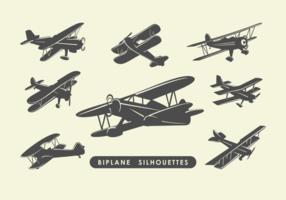 Silhouettes de biplan vecteur