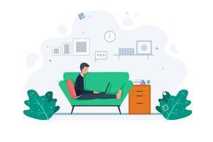 homme travaillant à domicile sur le canapé
