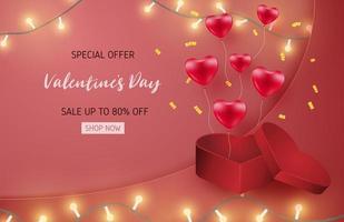 Bannière de vente de la Saint-Valentin avec des ballons coeur et boîte-cadeau