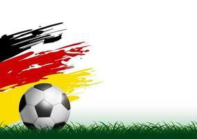 ballon de football sur l'herbe avec coup de pinceau drapeau Allemagne