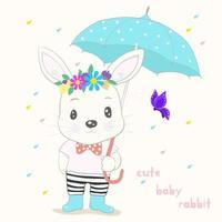 mignon petit lapin avec parapluie