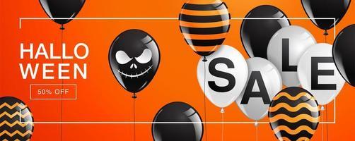bannière de vente halloween avec des ballons sur orange