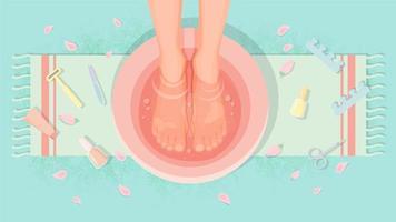 vue de dessus des pieds féminins dans l'eau pendant la pédicure