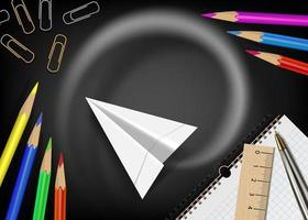 tableau noir avec avion en papier volant et fournitures scolaires