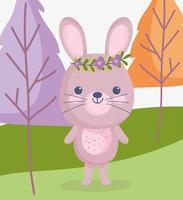 petit lapin portant une couronne de fleurs à l'extérieur vecteur