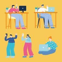 jeunes hommes et femmes utilisant des appareils électroniques