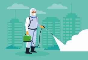 un travailleur de la biosécurité désinfecte la rue