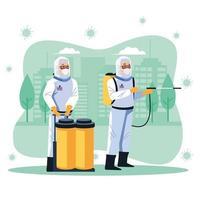 les travailleurs de la biosécurité désinfectent la rue