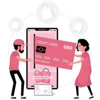 dame insère une carte de crédit dans l'écran du téléphone