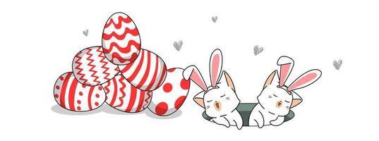 2 lapins dans le trou avec des oeufs de Pâques crépis