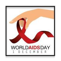 main avec ruban pour la journée mondiale du sida