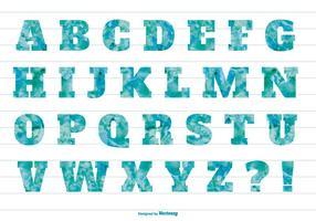 Alphabet texturé à l'aquarelle bleue