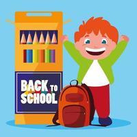 petit garçon étudiant avec des crayons de couleurs scolaires