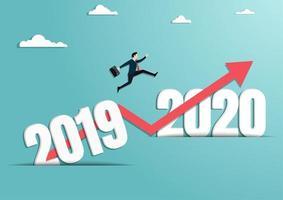 homme d & # 39; affaires sautant à la nouvelle année de 2020 vecteur