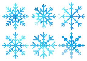 Vecteur libre de flocons de neige d'aquarelle