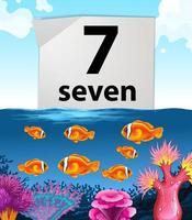 numéro sept avec sept poissons nageant dans la mer