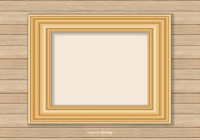 Cadre en or sur fond de mur en bois vecteur