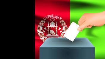 Main mettant le bulletin de vote dans l'urne avec le drapeau afghan