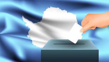 Main mettant le bulletin de vote dans l'urne avec drapeau antarctique