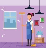 Femme de ménage avec balai et pelle à poussière