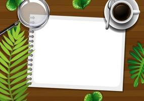 Éléments de bureau vue de dessus avec des feuilles vertes