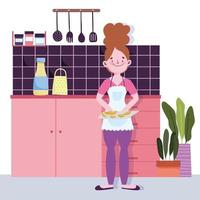 fille avec des tranches de fruits sur une planche à découper dans la cuisine