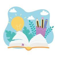 livre ouvert, crayons dans une tasse, idée et feuilles