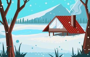 maison rouge au bord du lac gelé en hiver