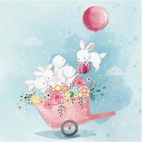 jolis lapins dans le panier recevant un cadeau vecteur