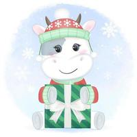 vache avec boîte-cadeau en hiver