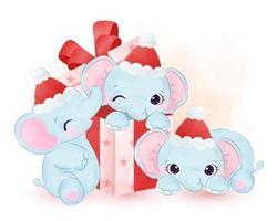éléphants mignons jouant dans des coffrets cadeaux de Noël