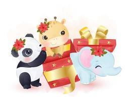 animaux mignons jouant dans des coffrets cadeaux de Noël