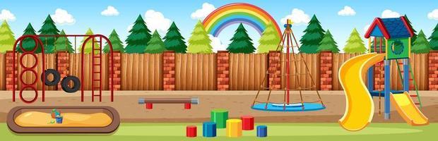 aire de jeux pour enfants dans le parc avec arc en ciel