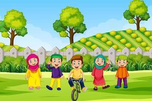 enfants musulmans à l'extérieur dans le champ vecteur