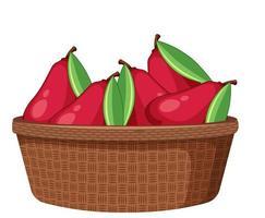 Pommes roses dans le panier isolé sur fond blanc