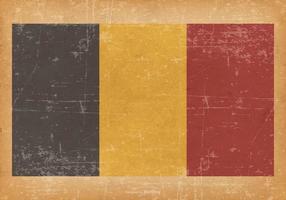 Drapeau de la Belgique sur fond grunge vecteur